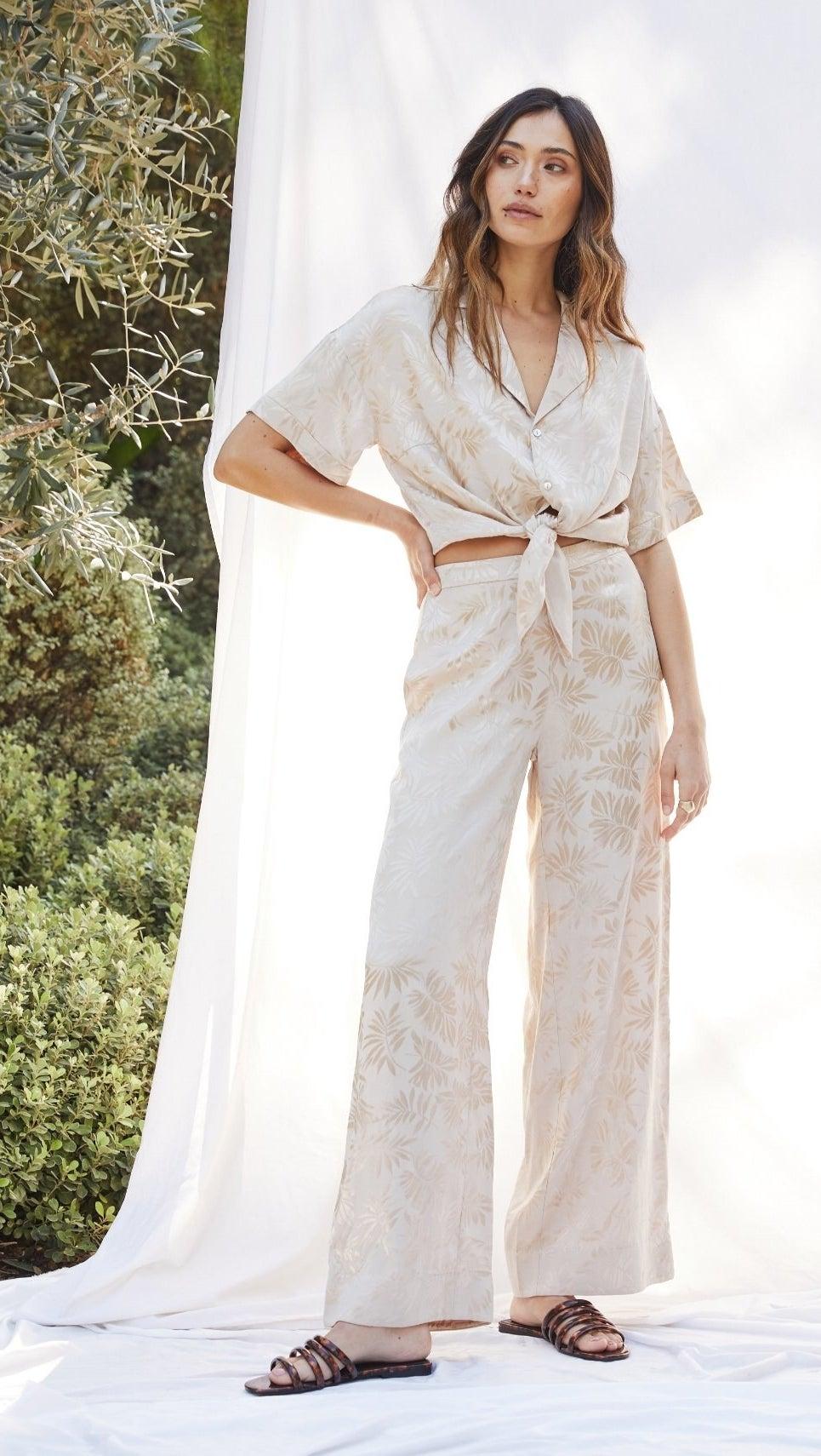 model wearing the leaf-printed cream set