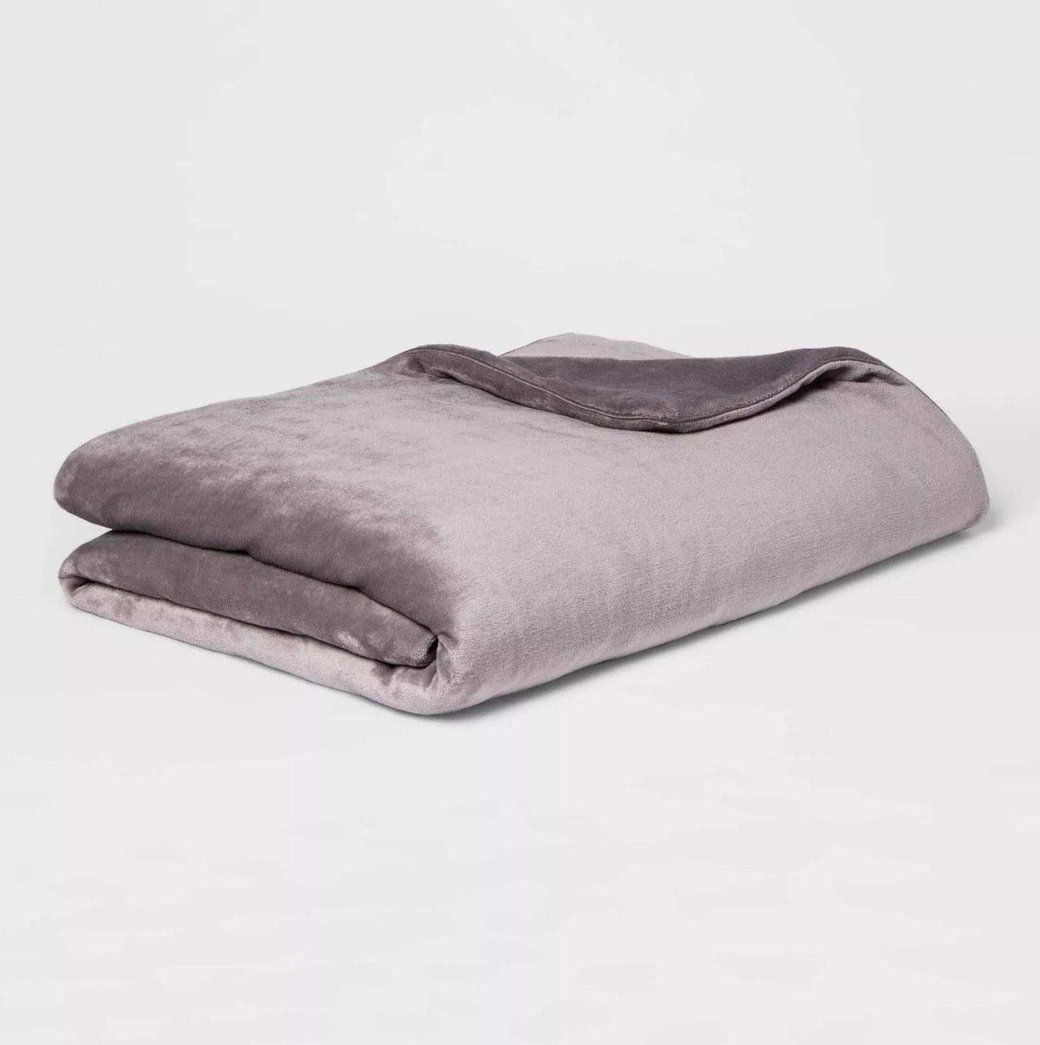 the folded blanket in light purple