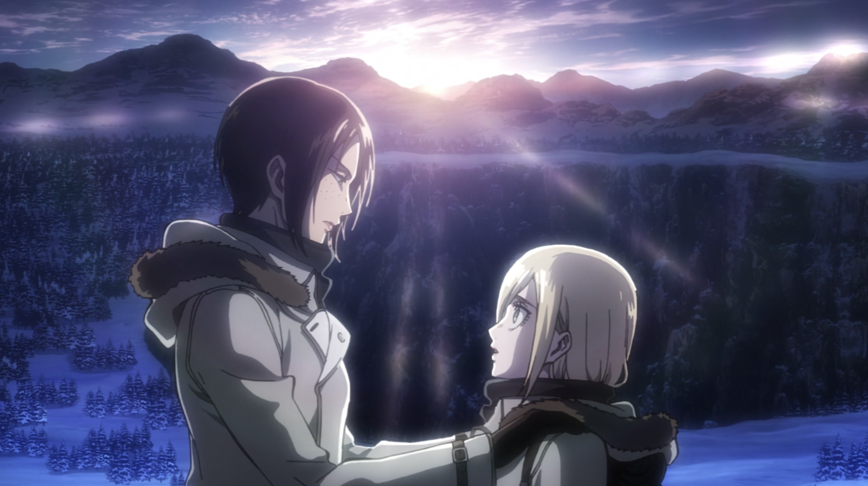 Ymir and Christa looking into each other's eyes while overlooking the snowy mountains.