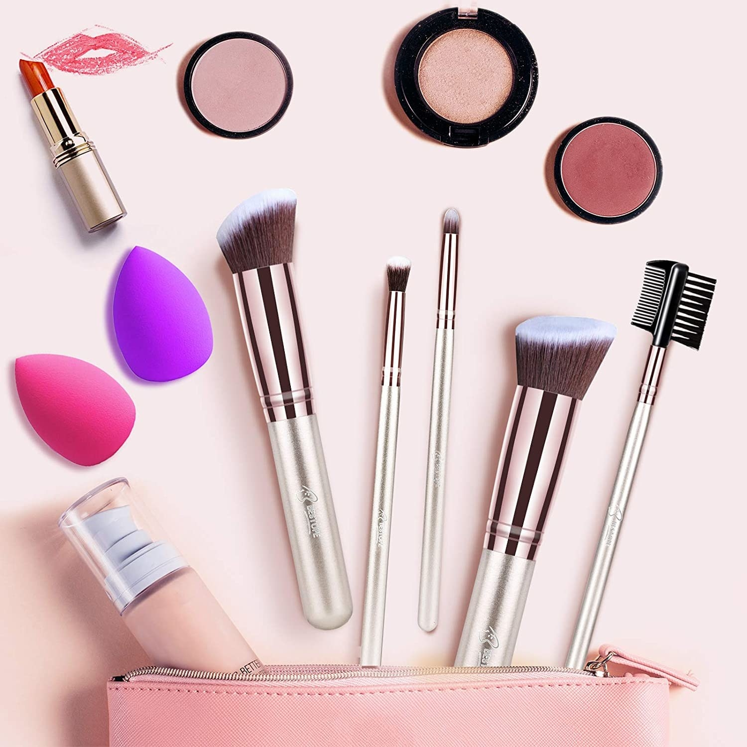 the brushes with makeup next to a bag