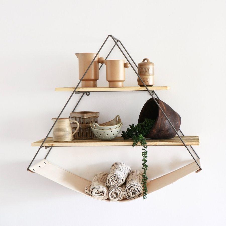 the triangle sling shelf mounted on a wall