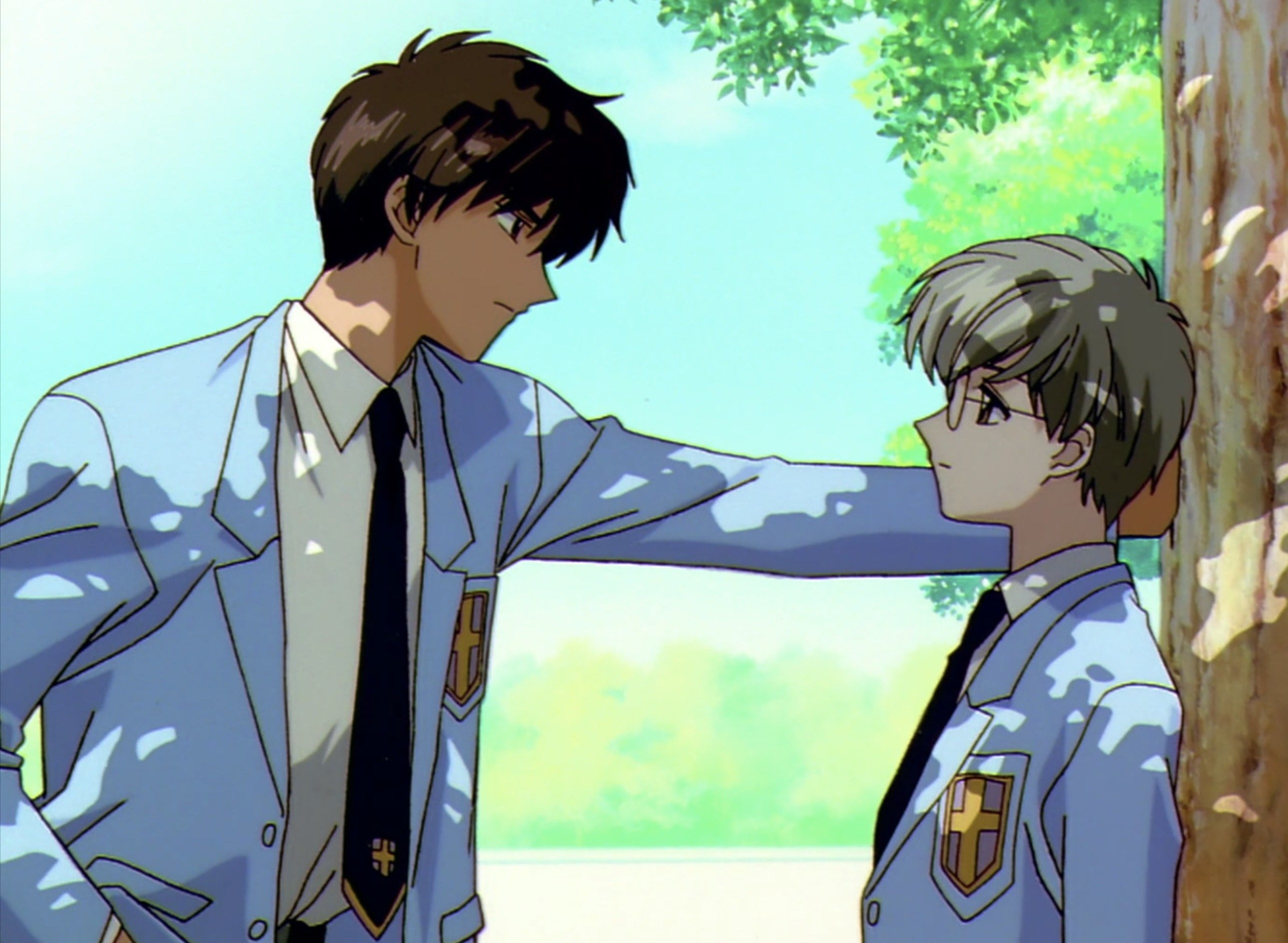 Touya leaning into Yukito as they talk under the trees.