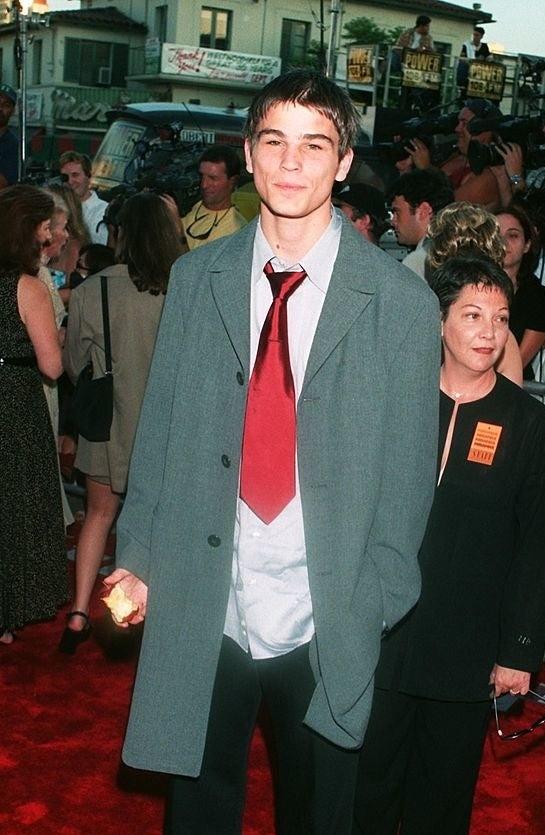 Josh Hartnett with a large red clown tie