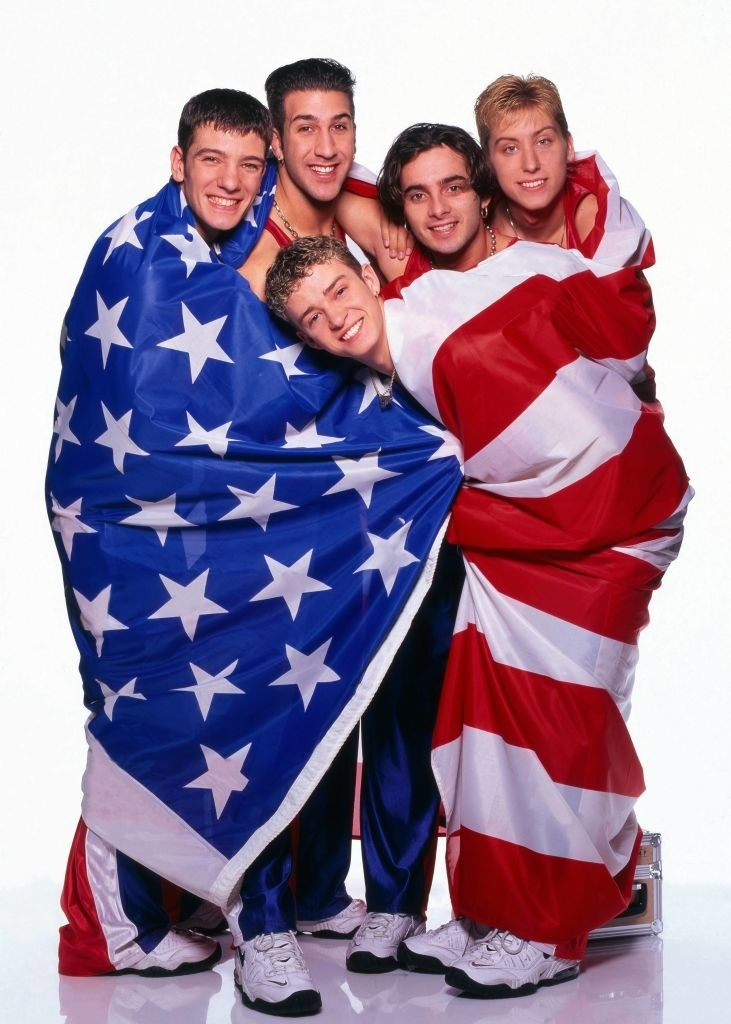 NSYNC covered in an American flag