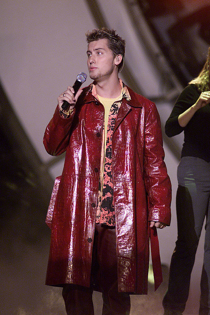 Lance Bass in a red coat