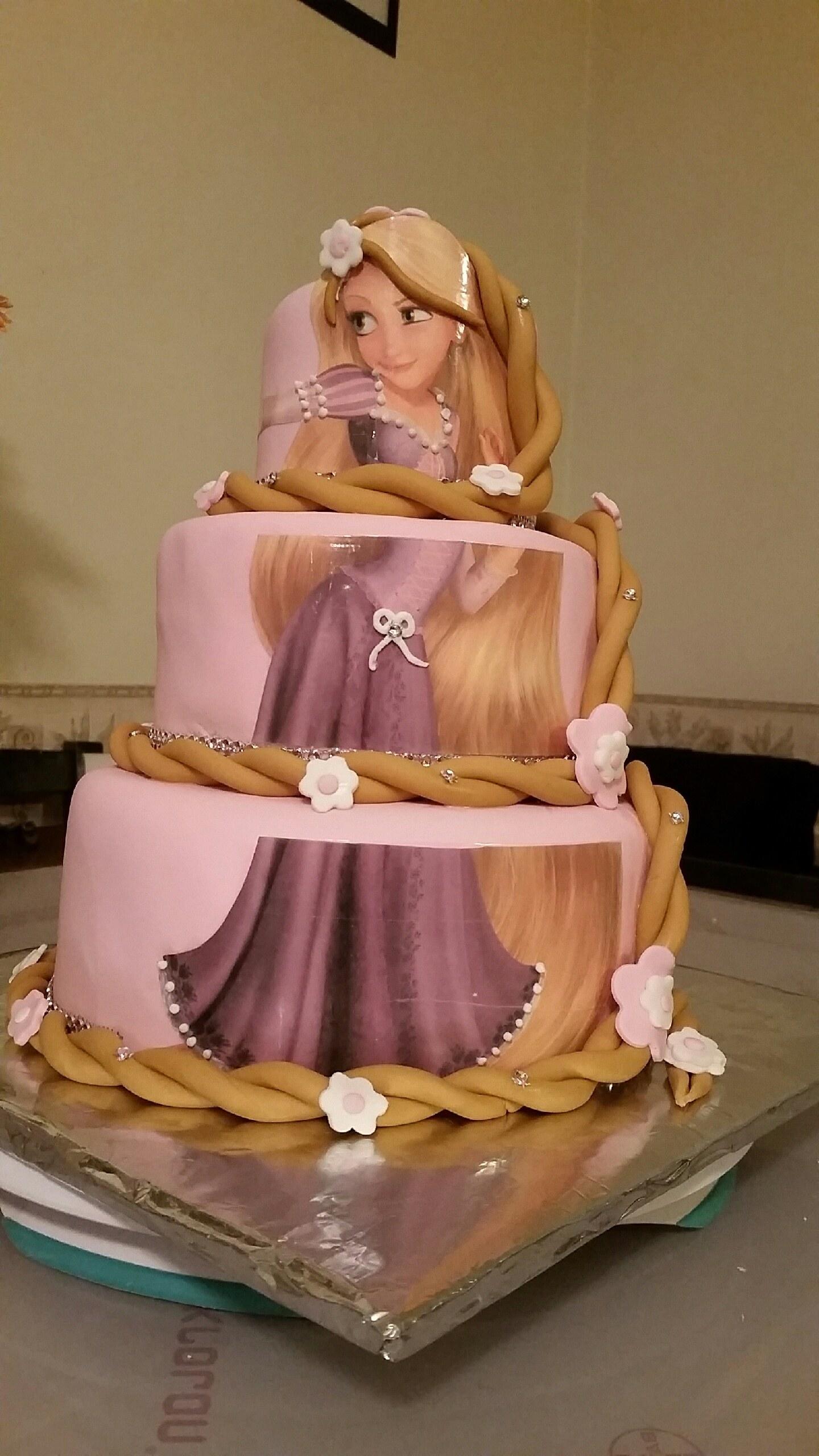 3-tier gorgeous rapunzel cake with long fondant hair