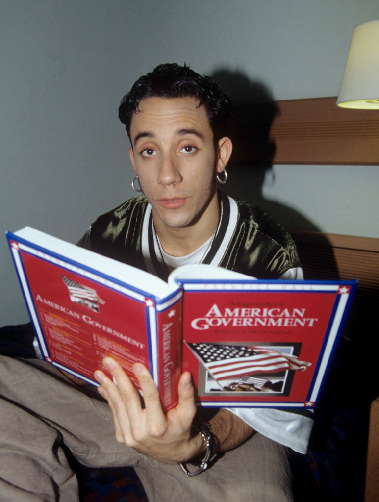 AJ McLean reading an American government book