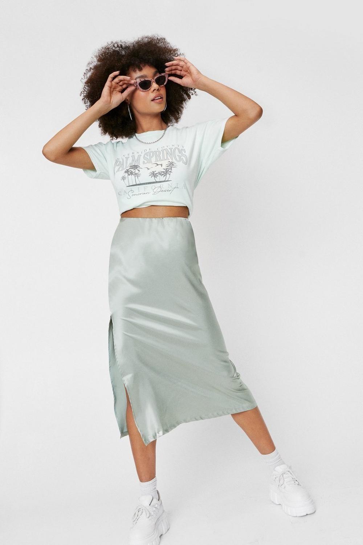 model wearing the light mint midi skirt