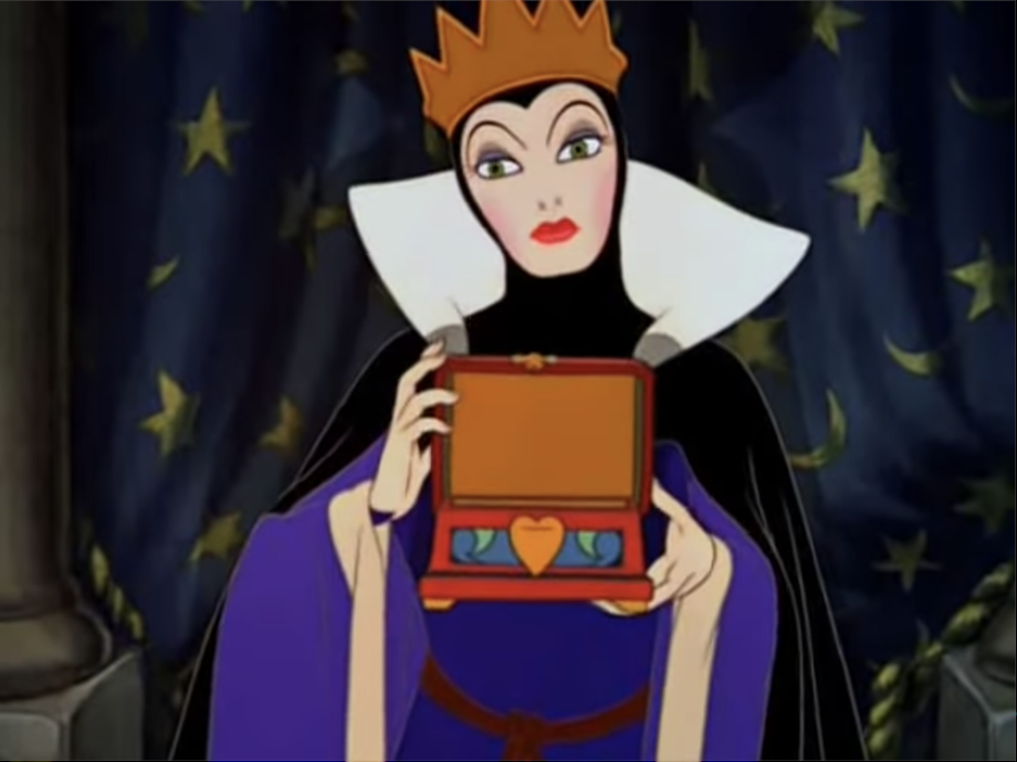 the evil queen holding the box for snow white's heart