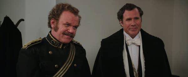 """Watson and Holmes smiling in """"Holmes & Watson"""""""