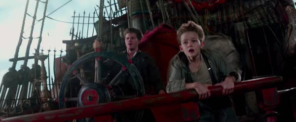 """Hook and Peter looking worried on a boat Hook's driving in """"Pan"""""""