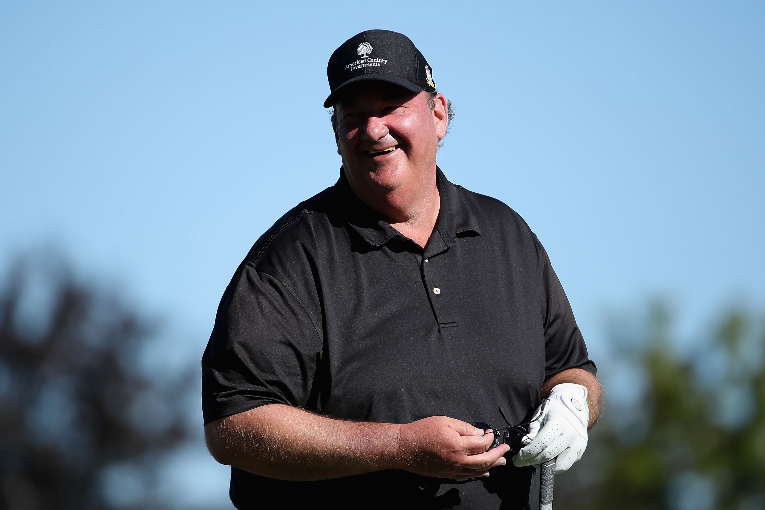 Brian laughs while out on a golf course