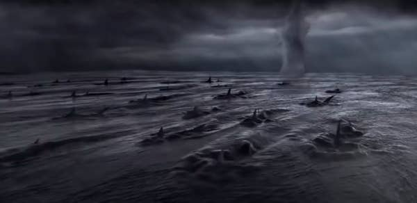Bad CGI sharks in the water in front of a tornado, seen from above the surface of the water
