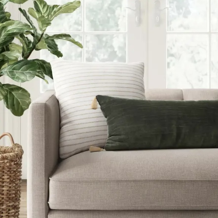 Throw pillow surrounded by others on couch