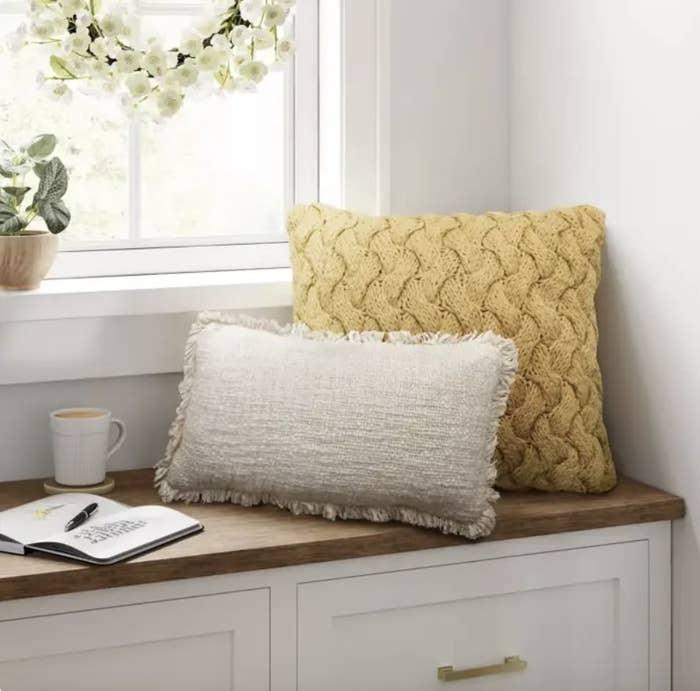 Pillow displayed on bench