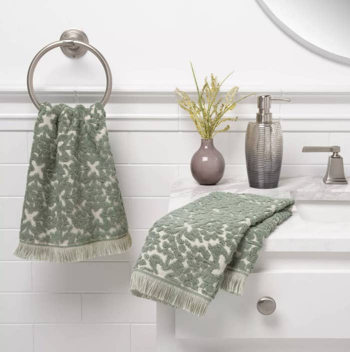 Towels sitting on bathroom counter