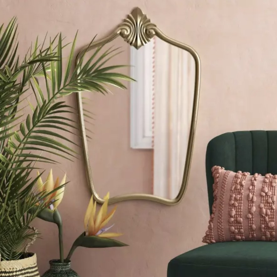 Decorative wall mirror hanging in living room