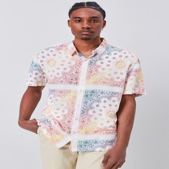 model wearing rainbow paisley printed short-sleeved button down
