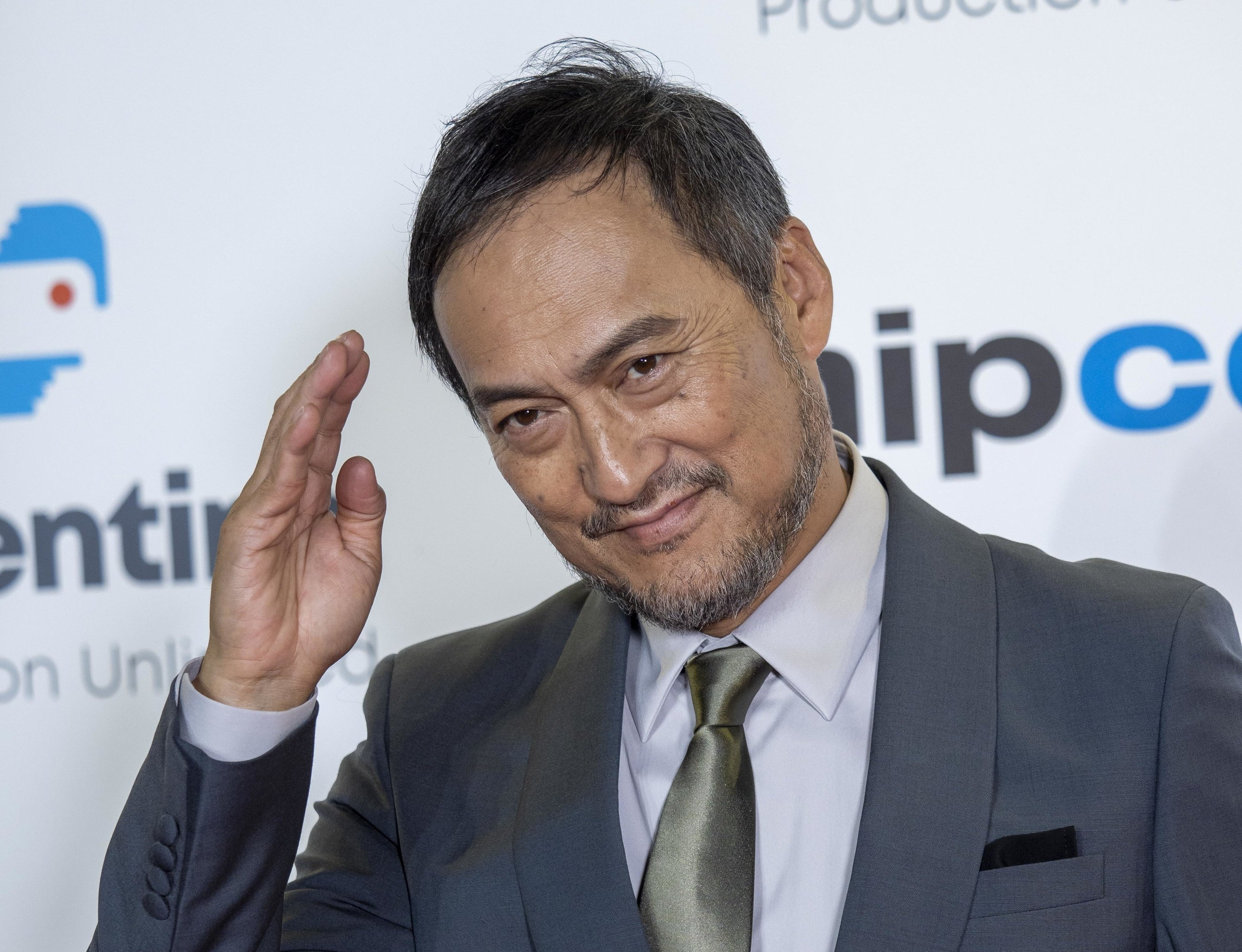 Ken Watanabe giving a salute on the red carpet