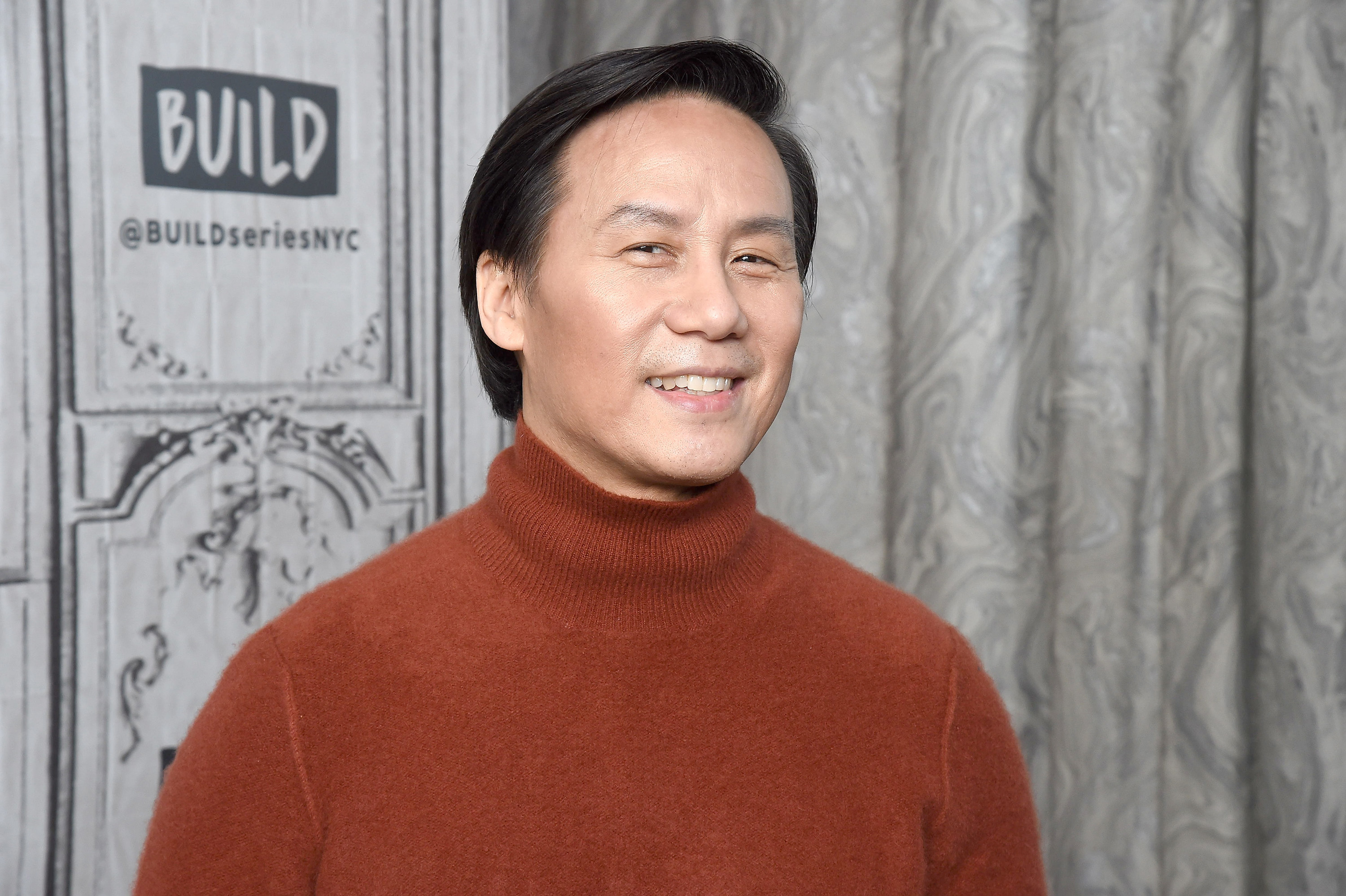 BD Wong, in a turtleneck, smiles for the camera