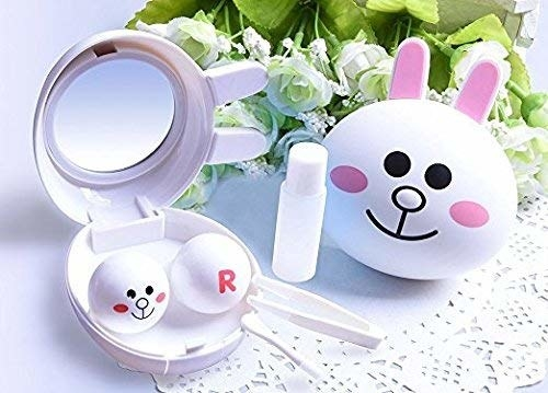 A rabbit-shaped contact lens kit with tweezers and the contact lens solution.