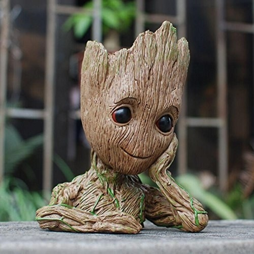 A Groot flower pot on a table