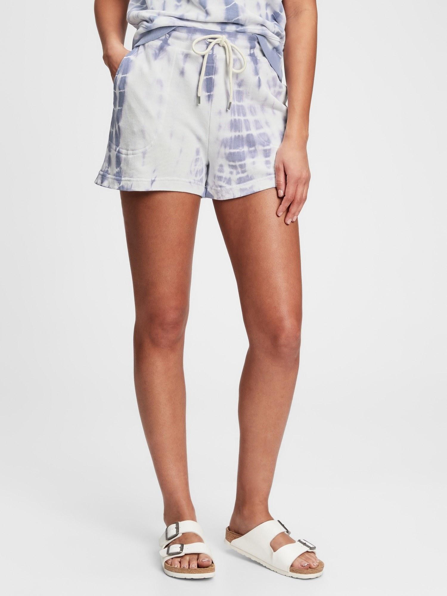 a model in purple tie dye shorts