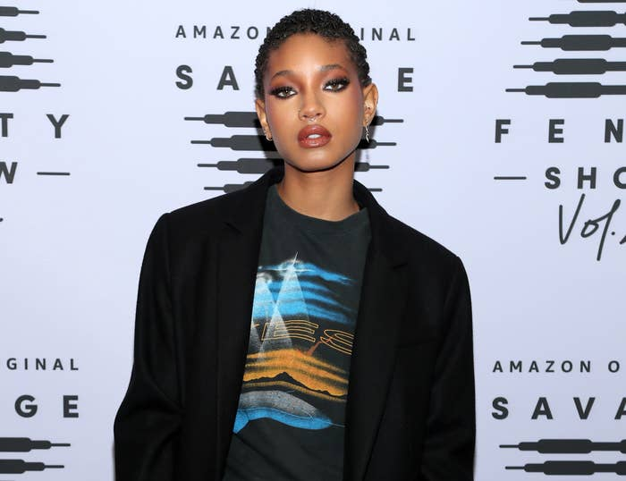 Willow poses agt an event in a black blazer and t-shirt