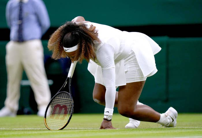 Serena Williams falls to the ground during first round match at Wimbledon
