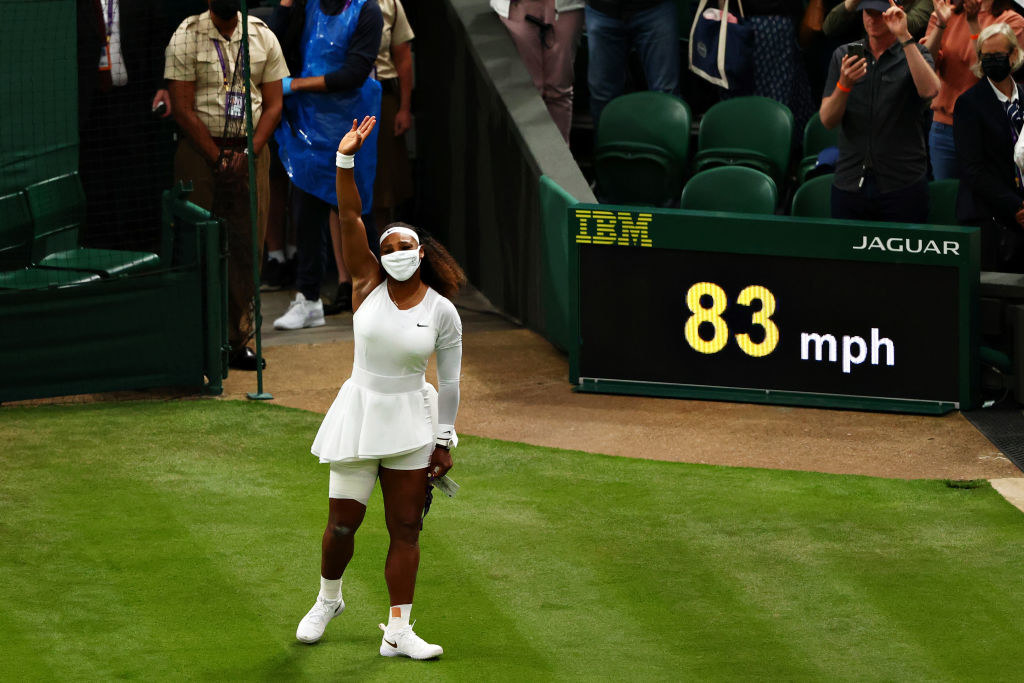 Serena Williams waves goodbye to the crowd after retiring due to injury