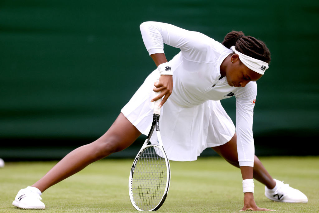 Coco Gauff steadies herself as she slips during her first-round match at Wimbledon