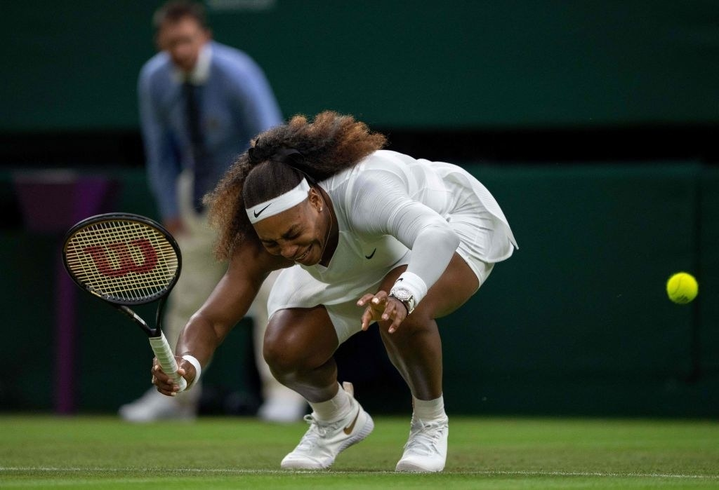 Serena Williams cries in pain as she falls to the ground during her first-round match at Wimbledon.