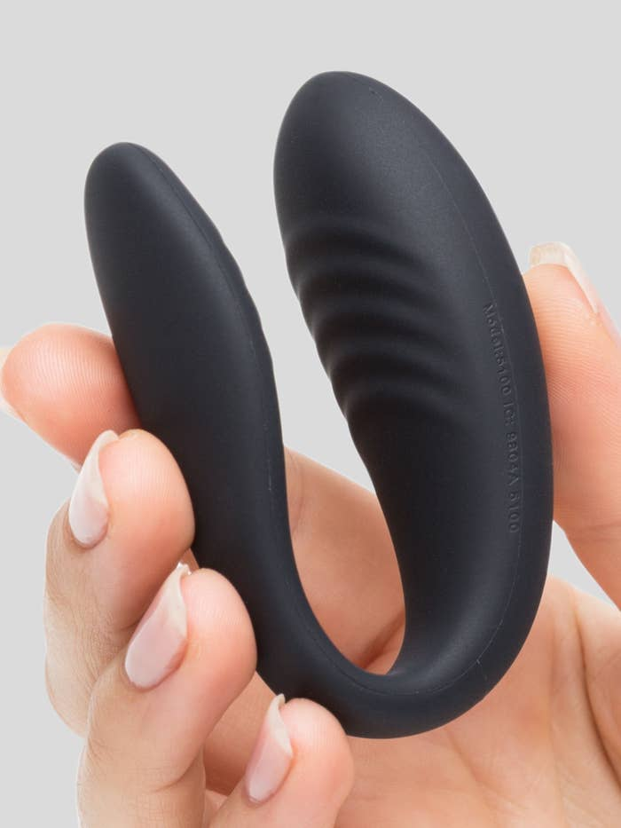 a model's hand holding up the we-vibe X