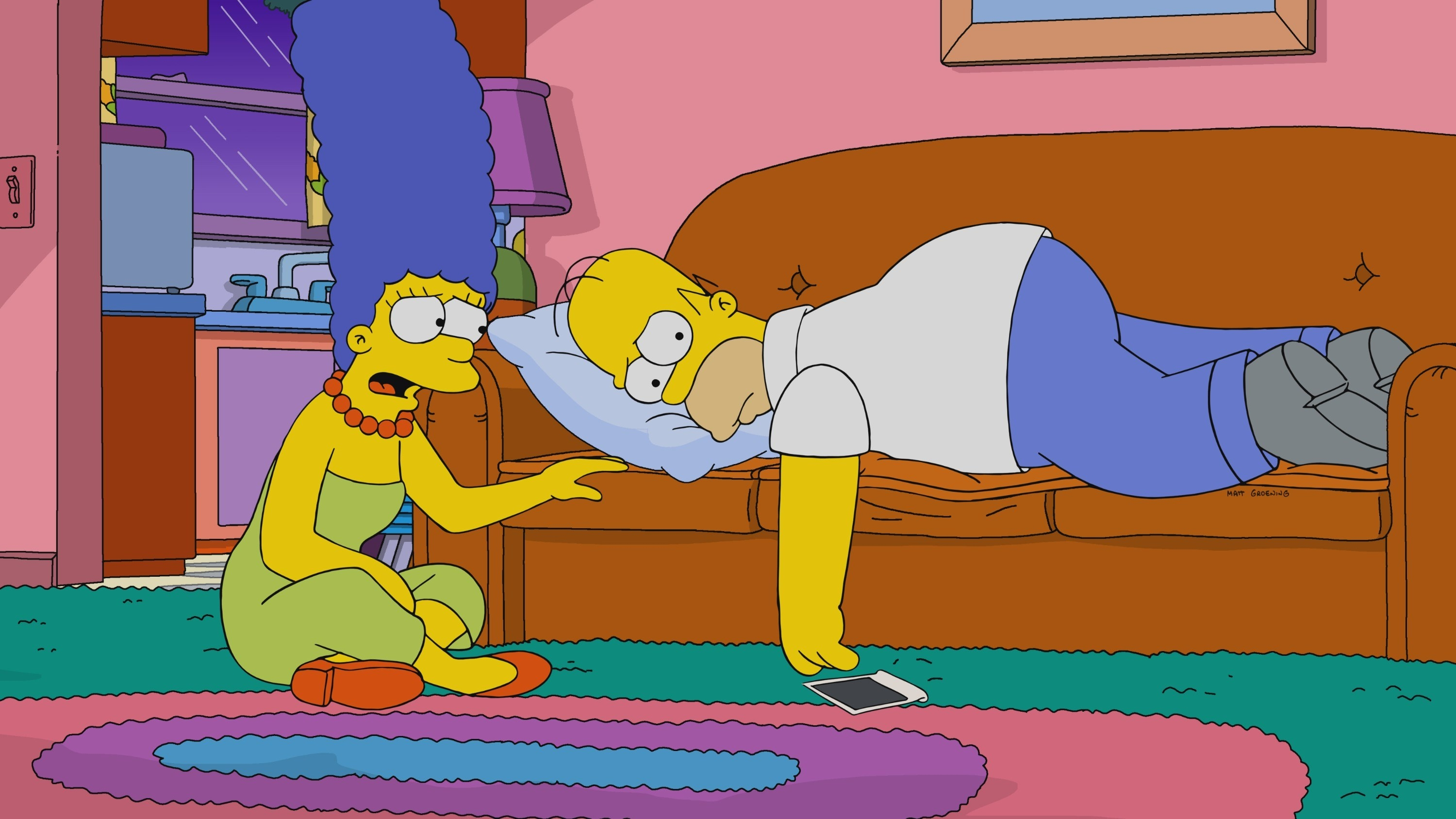 Homer and Marge looking unhappy