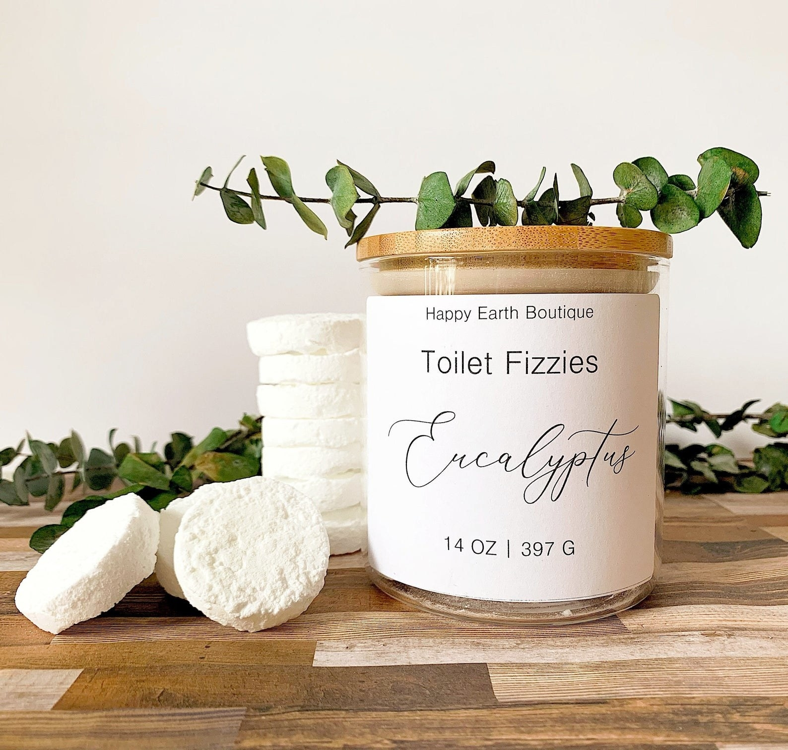 several eucalyptus toilet fizzies next to a jar full of more