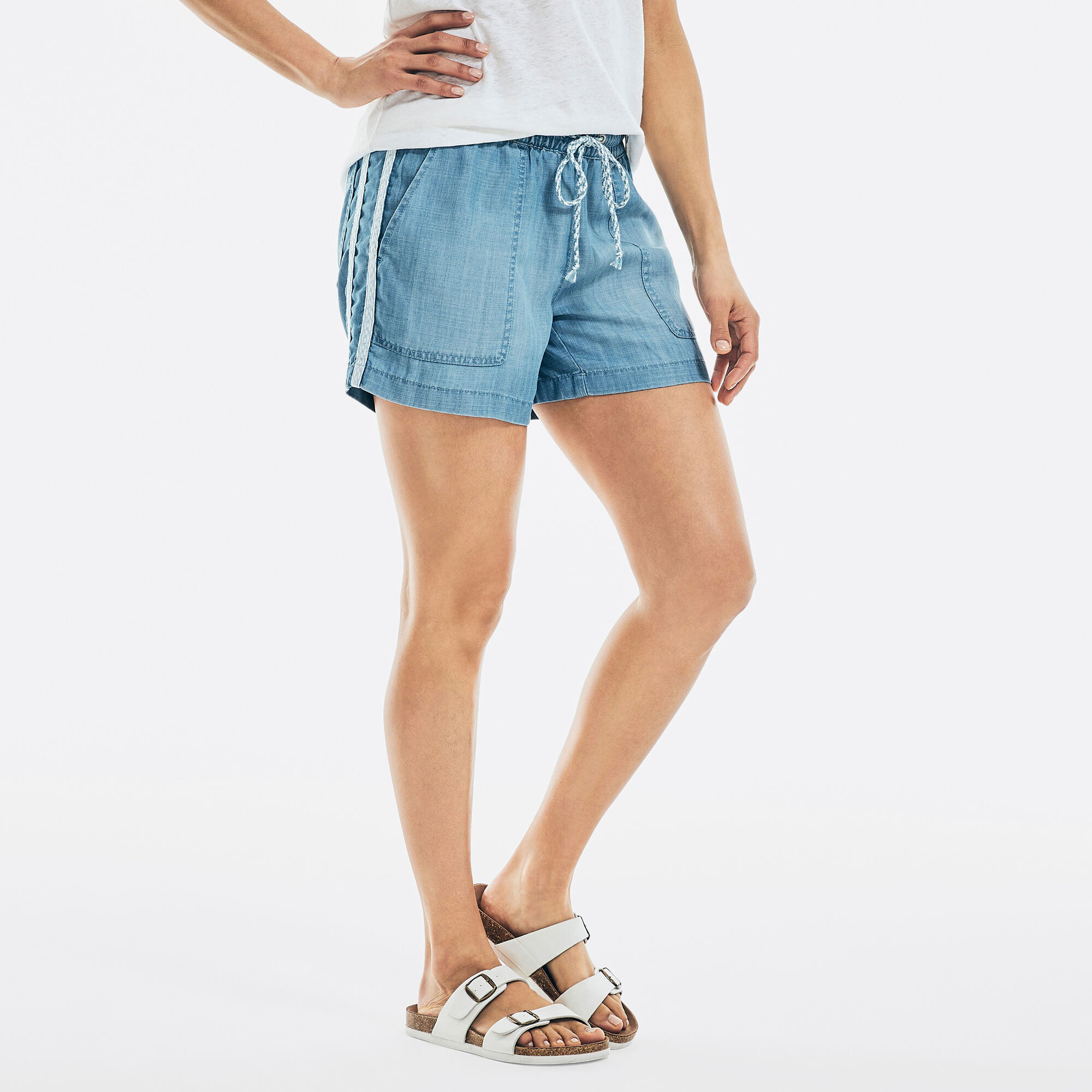a model in pull on denim shorts
