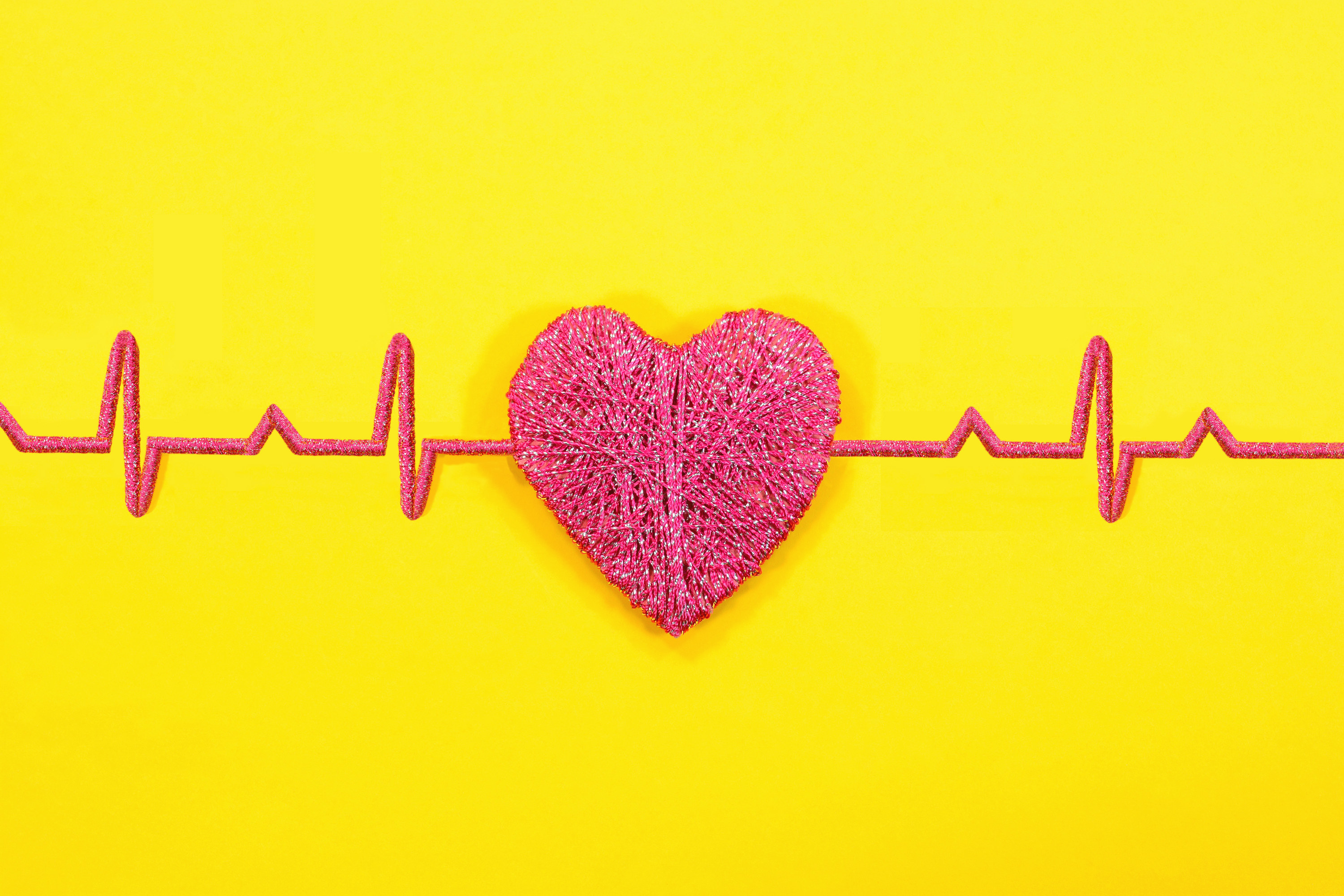 An image of a heart on a yellow background