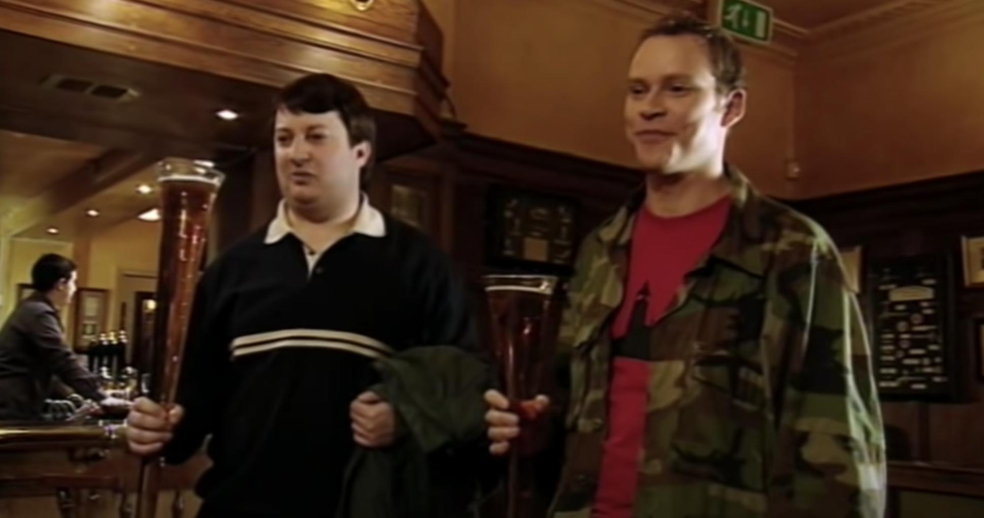 men holding large glasses of beer