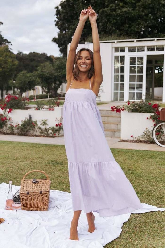a model wearing a lavender maxi dress while at a picnic