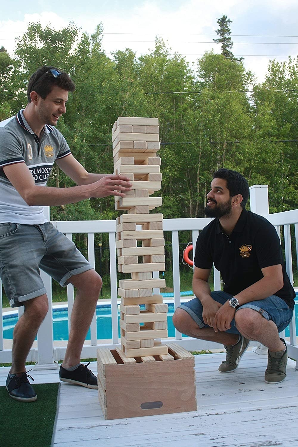 two models play the stacking blocks game outside