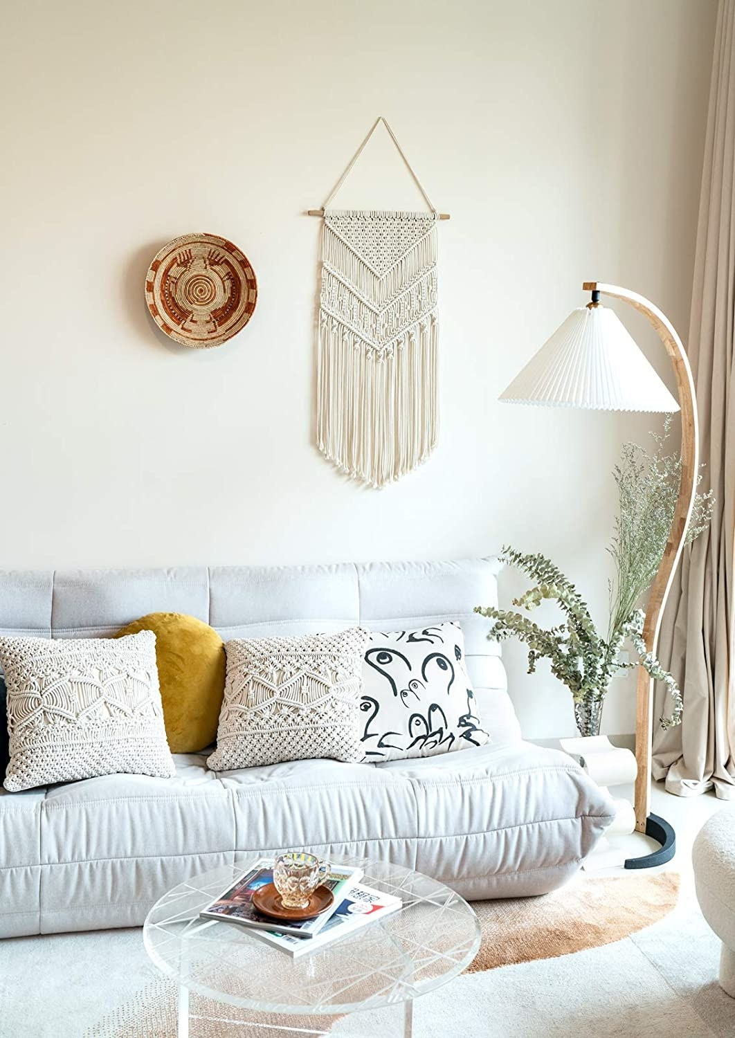 The tapestry hanging above a sofa