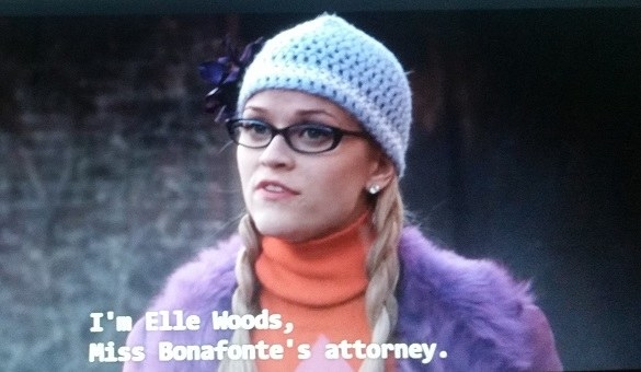 Elle, wearing two braids and a hat with a bow on it, addresses Paulette's ex.