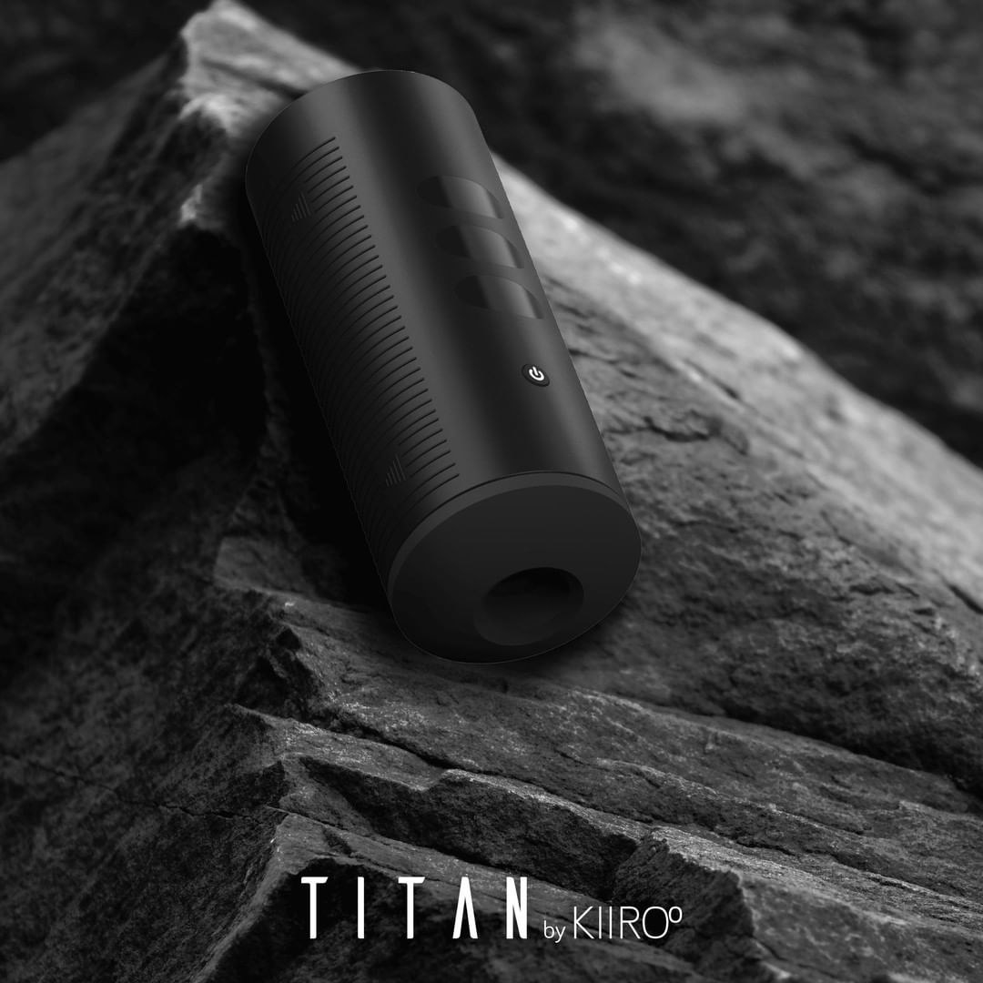 the titan interactive penis stroker on top of a black boulder