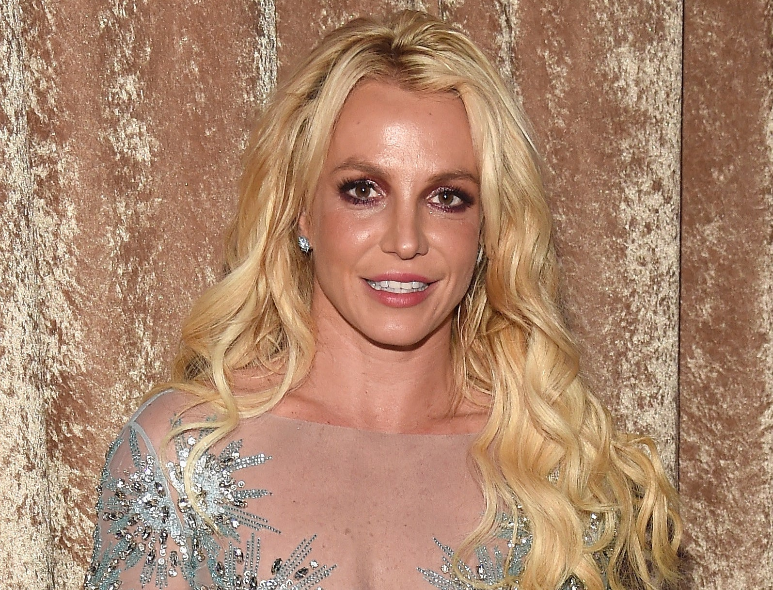 Britney smiles while attending an event