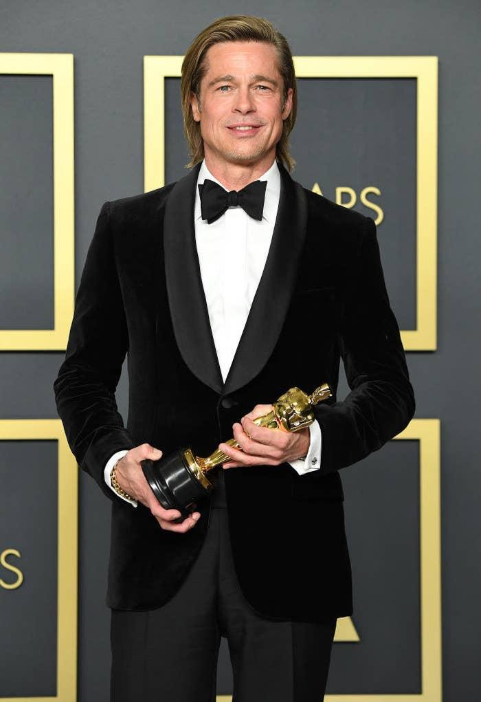 Pitt at the Academy Awards holding an Oscar