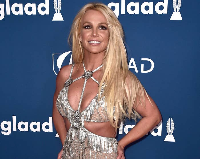 Britney smiles while wearing a diamond encrusted dress