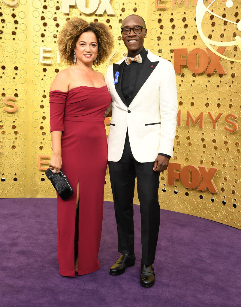 Bridgid Coulter (L) and Don Cheadle arrives at the 71st Emmy Awards
