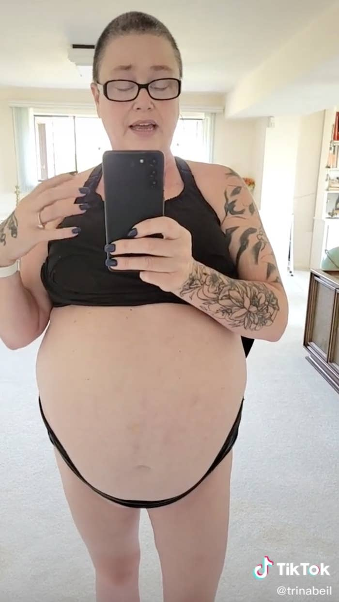 Woman with very distended bare belly