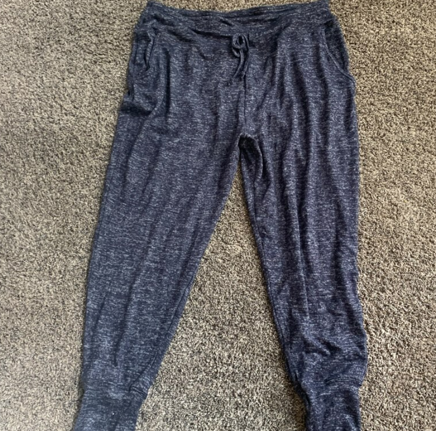 A pair of dark colored jogger pants.