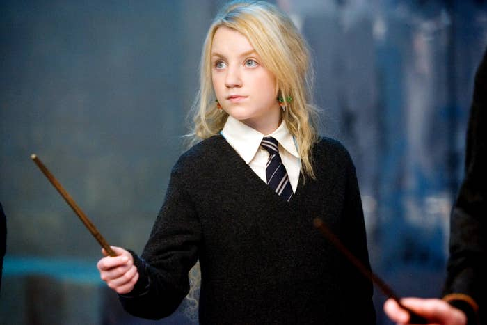 Evanna Lynch brandishes her wand as Luna Lovegood in Harry Potter and the Order of the Phoenix